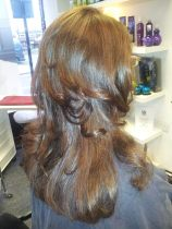Bouncy blow dry on naturally curly hair, by Faye